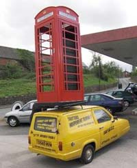 Picture of a Phoney Box being carried vertically on the Trotter's yellow Reliant van